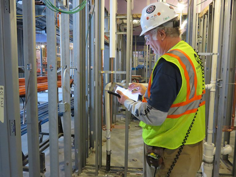 4. Field Worker Using Technology on Jobsite; Photo Courtesy of ArchKey Solutions