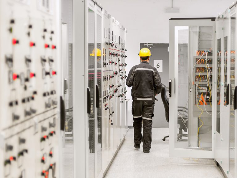 Electrical Panel Hallway with Worker (2)_STOCK